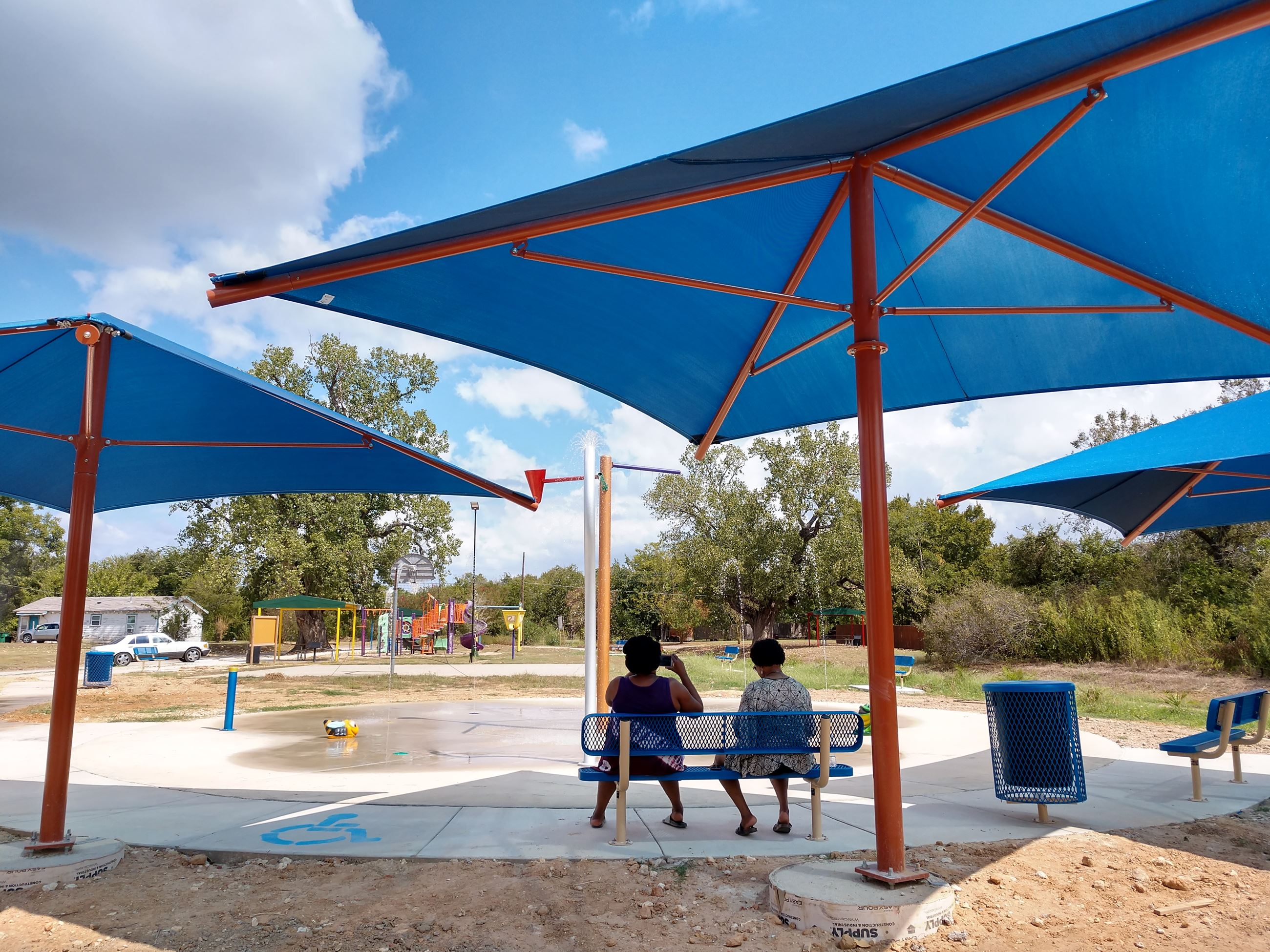 Shaded seating at Splash Pad